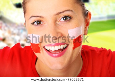 A picture of a happy Polish female fan cheering over stadium background