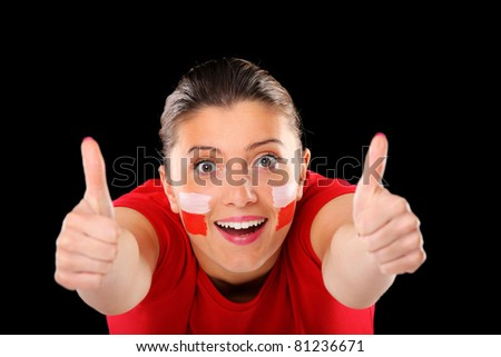 """A picture of a happy Polish female fan showing """"ok"""" sign over black background. Focus on face - stock photo"""