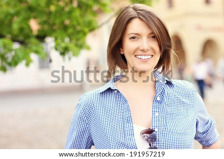 A picture of a happy tourist in Slovakian Bardejov - stock photo
