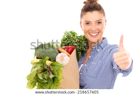A picture of a happy woman with vegetables showing ok over white background - stock photo