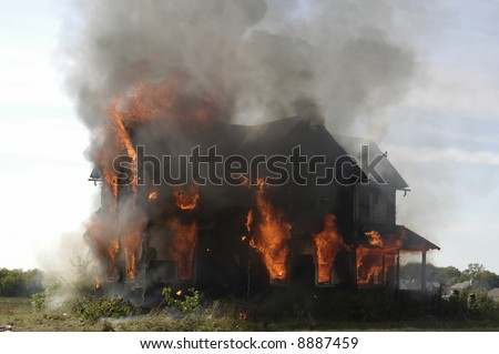 A picture of a house on fire before the firemen arrived - stock photo