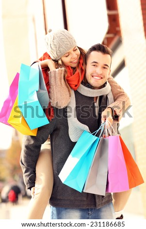 A picture of a joyful couple shopping in the city