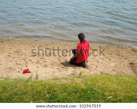 A picture of a little boy at the beach