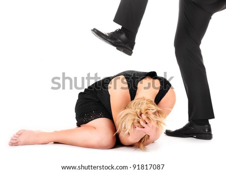 A picture of a male leg treading on a female employee over white background - stock photo