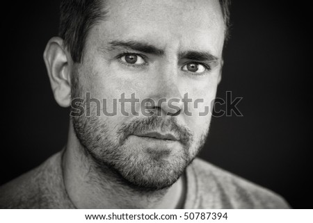 A picture of a man with a five o'clock shadow - stock photo