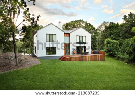 A picture of a modern luxury house and garden - stock photo