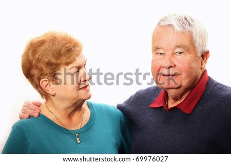 A picture of a nice senior couple talking against white background - stock photo
