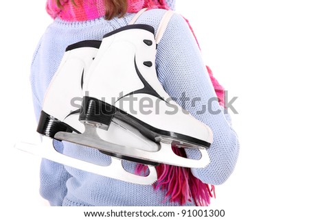 A picture of a pair of figure skates on the back of the woman - stock photo