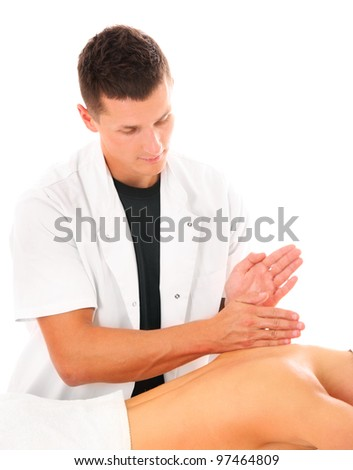 A picture of a physio therapist giving a back massage over white background - stock photo