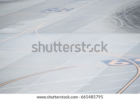 A picture of a runway with lines drawn.