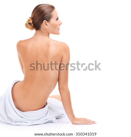 A picture of a sensual woman in a white towel over white background - stock photo