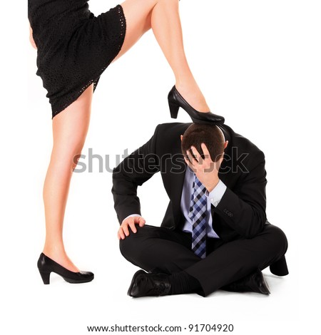 A picture of a sexy woman dominating a man over white background - stock photo