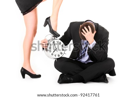 A picture of a sexy woman showing a deadline to her employee over white background - stock photo