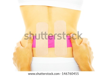A picture of a special physio tape being put on the back muscle over white background