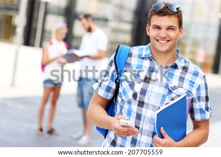 A picture of a student using smartphone in the campus - stock photo
