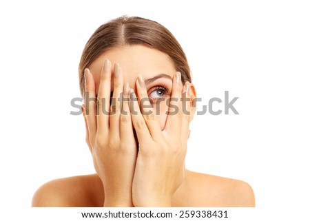 A picture of a terrified woman covering her face over white background - stock photo