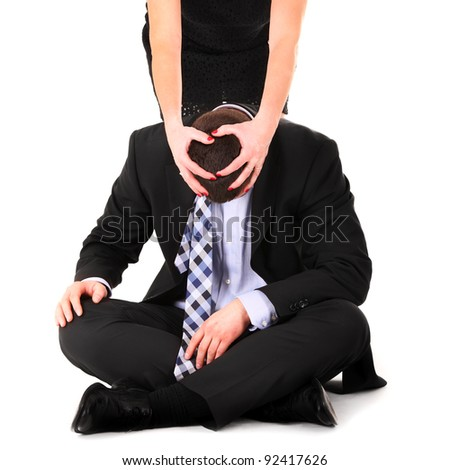 A picture of a woman dominating a man over white background - stock photo