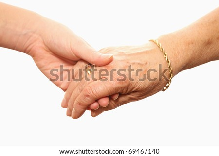 A picture of a young and an old hand over white background