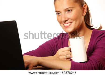 A picture of a young beautiful wife working on her laptop over white background