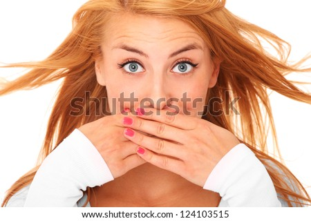 A picture of a young beautiful woman covering her lips with hands over white background - stock photo