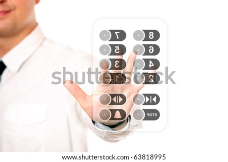 A picture of a young businessman touching the elevator panel over white background - stock photo