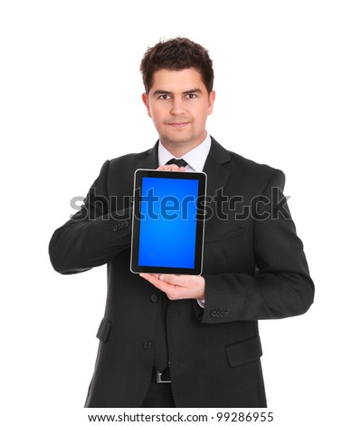 A picture of a young businessman with his tablet computer over white background