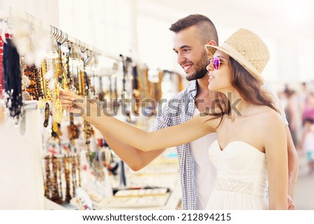 A picture of a young couple buying souvenirs - stock photo