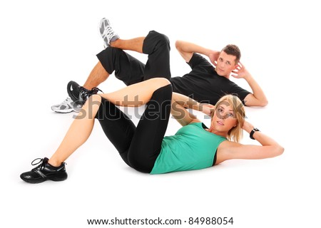 A picture of a young couple doing sit-ups over white background