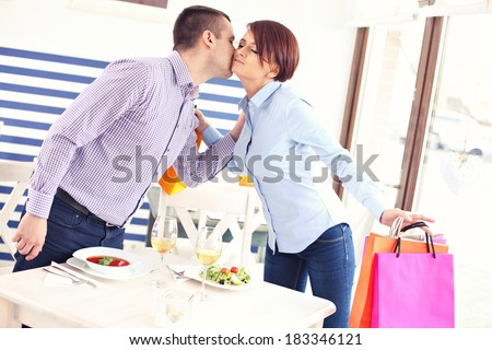 A picture of a young couple meeting in a restaurant - stock photo