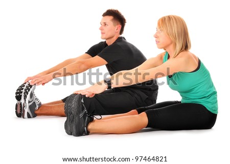 A picture of a young couple stretching over white background - stock photo