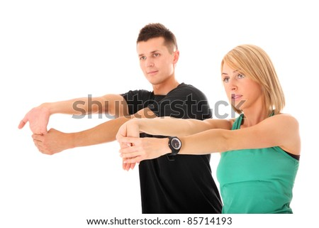 A picture of a young couple stretching together over white background - stock photo