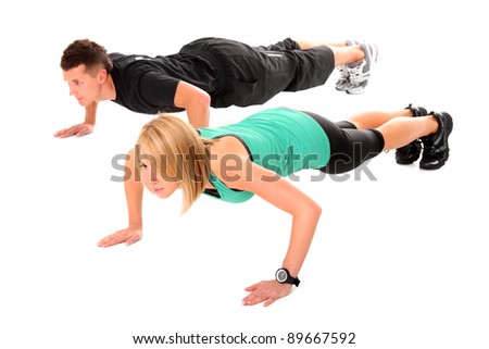 A picture of a young couple working out over white background - stock photo