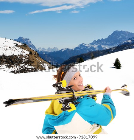 A picture of a young female skier enjoying snow in the Alps - stock photo