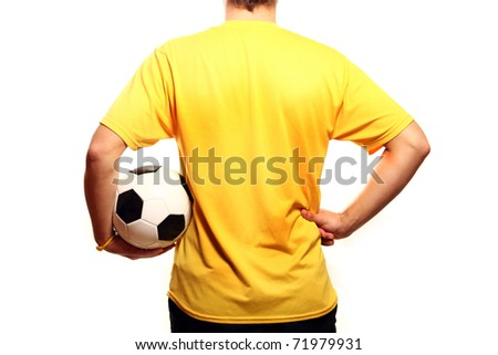 A picture of a young footballer in a yellow t-shirt with a football over white background