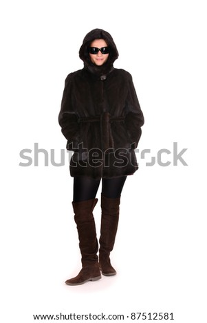 ... woman standing in a mink coat over white background - stock photo