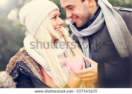A picture of a young happy couple holding heart