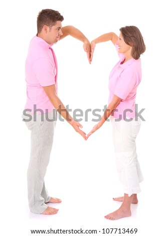 A picture of a young happy couple posing over white background - stock photo