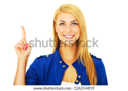 A picture of a young happy woman pointing at something over white background - stock photo