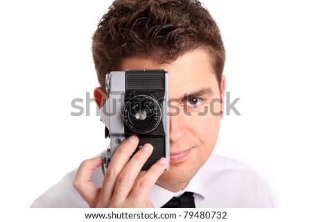 A picture of a young man trying to take a picture against white background