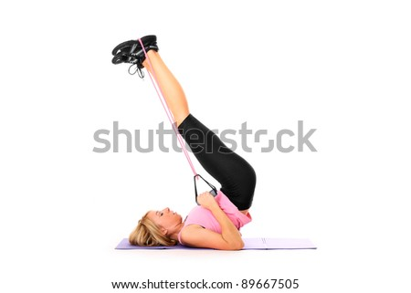 A picture of a young pretty girl exercising with a body trimmer over white background