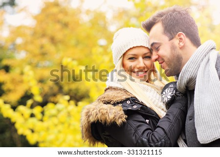A picture of a young romantic couple in the park in autumn - stock photo