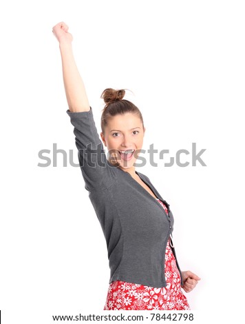 A picture of a young successful woman with her arms up, smiling over white background - stock photo