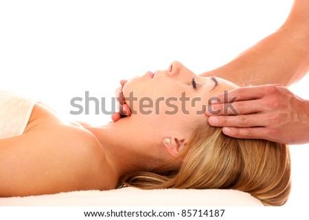 A picture of a young woman having a head massage over white background