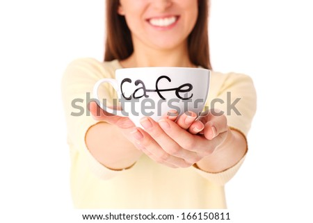 A picture of a young woman holding a cup of coffee over white background - stock photo