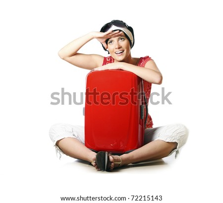 A picture of a young woman packed and looking forward to going on holidays