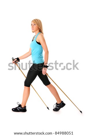 A picture of a young woman practising nordic walking over white background - stock photo