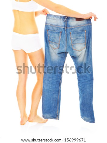 A picture of a young woman showing big pair of jeans - stock photo