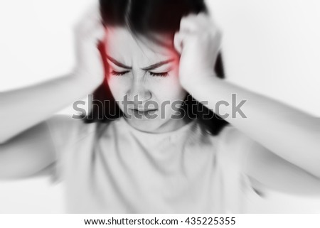 A picture of an adult young woman with migraine headache overworked and stressed - stock photo