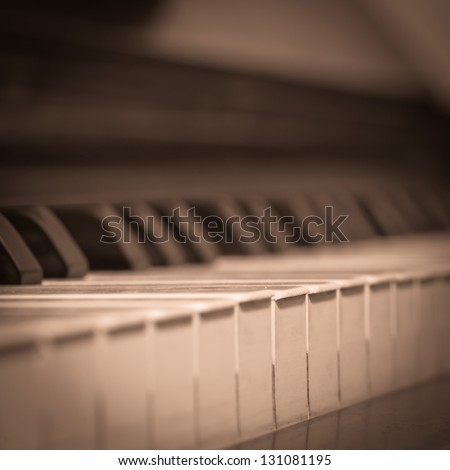 a picture of an old piano, vintage style - stock photo