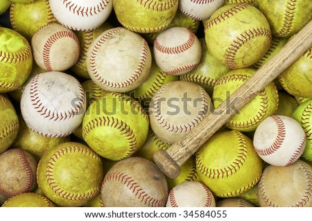 a picture of baseballs softballs and a bat